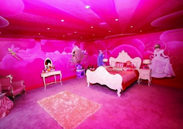A VERY pink bedroom with a disney princess theme. A little much ...