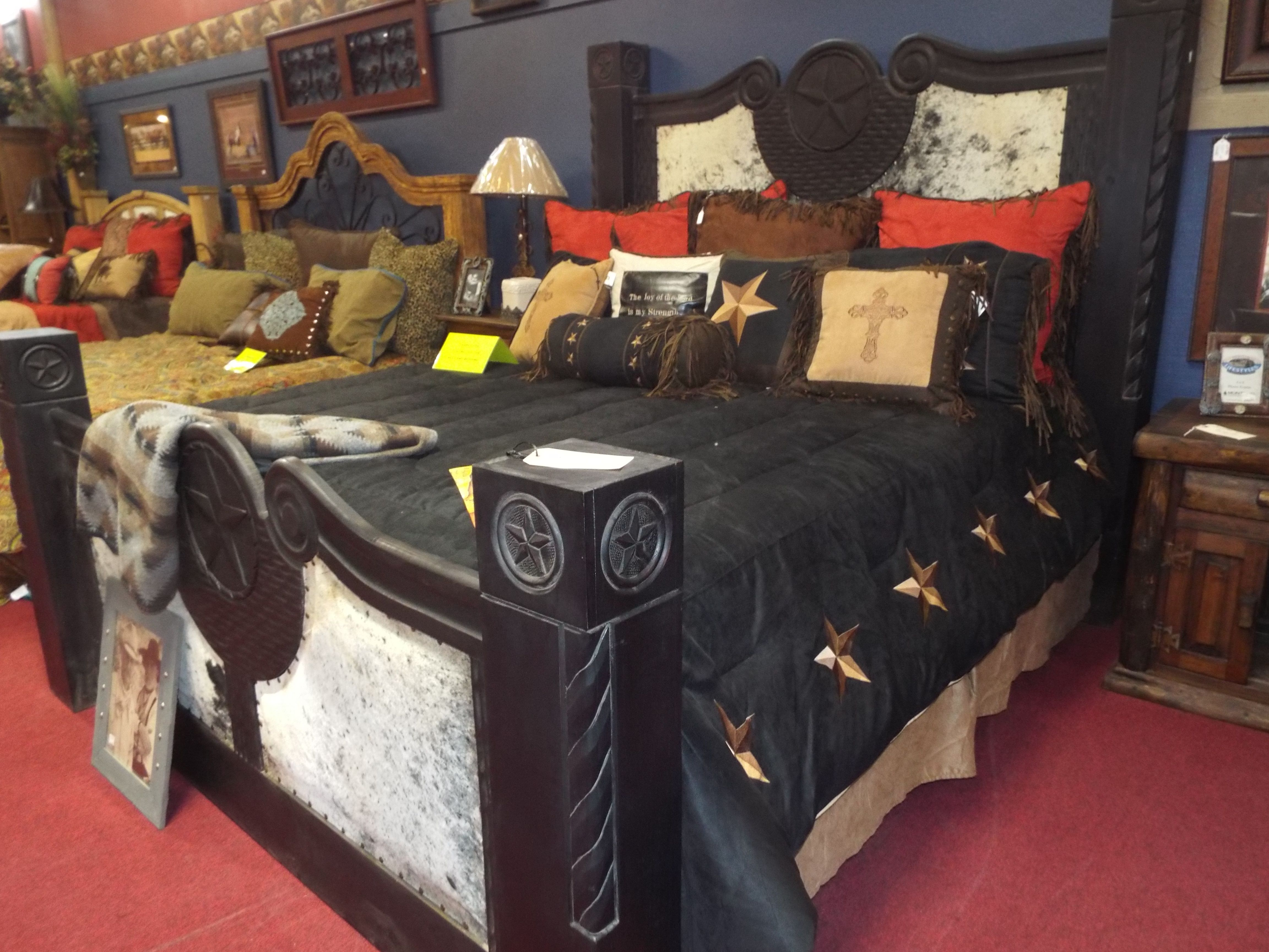 This bed is accented with hair-on hide and carved stars ...