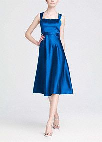 Vintage-inspired, this satin�style combines modern sophistication with old hollywood glamour.  Wide strap tank bodice is supportive while sweetheart�neckline is ultra�feminine.�  Tea-length skirt mixes flirty with flattering to create a timeless silhouette.  Lined Bodice. Back zip. Imported polyester. Dry clean only.  Available in our exclusive 44 color palette.  Get inspired by our colors.
