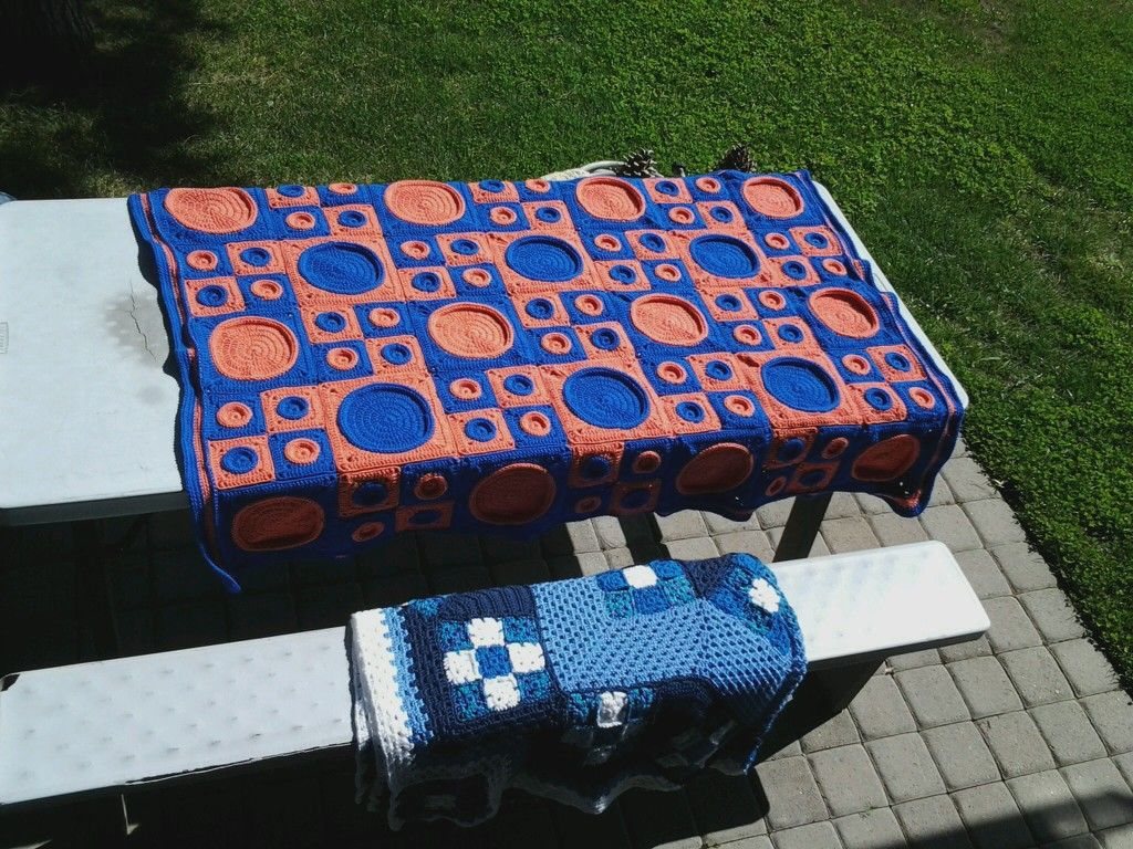 "This pattern "" '50s Flashback"" is from Herrschner's 2012 Nat'l Afghan Contest Winners Crochet Afghans.  My grandson changed the colors from black and white to blue and orange for the Boise State colors"