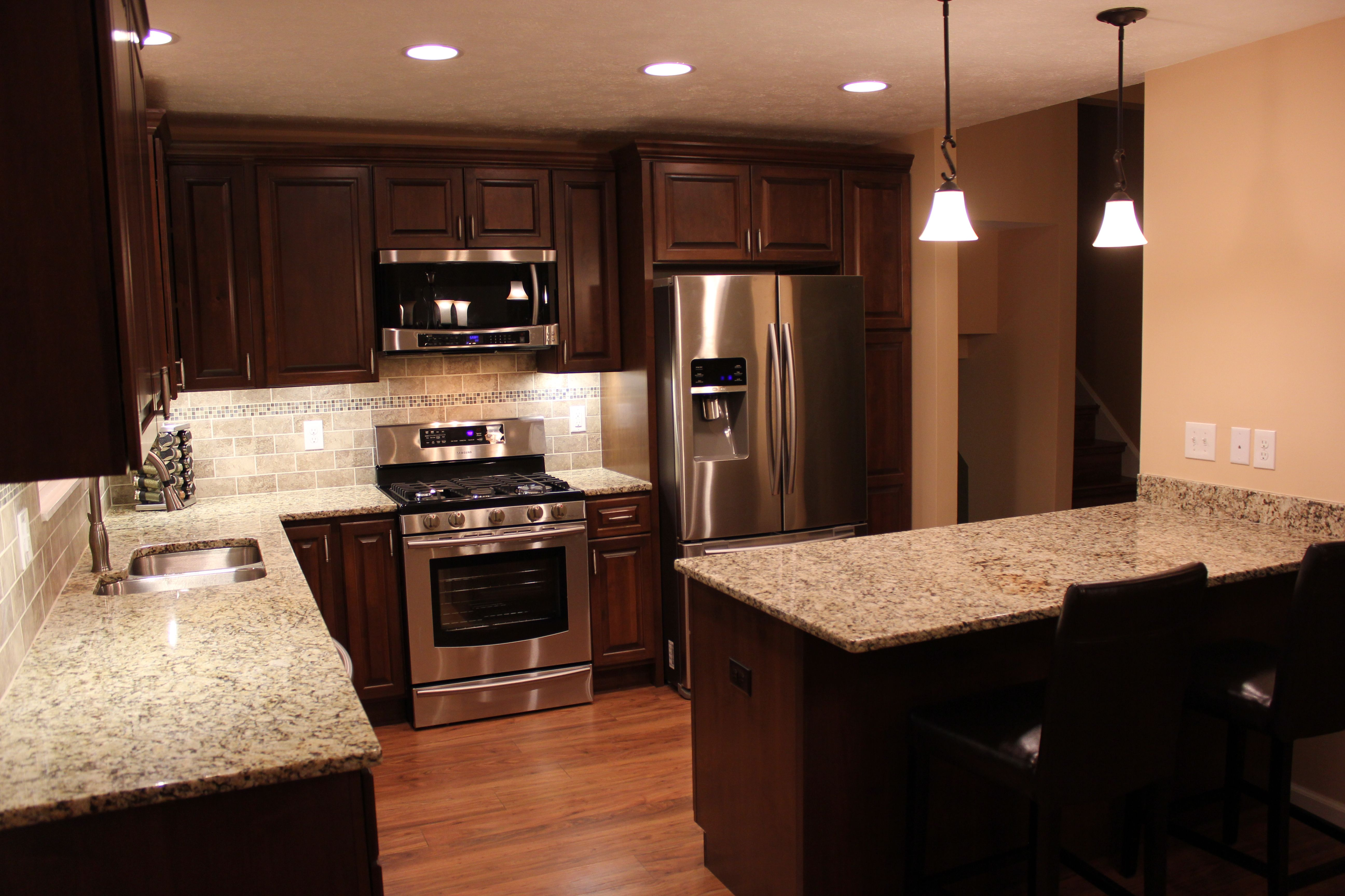Cherry Cabinets, Granite Countertops, Tile Backsplash, Pendant Lights,  Recessed Lighting Kitchen Remodeling
