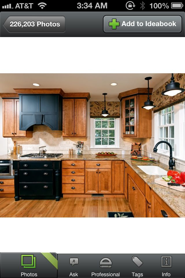 Black cabinets mixed with stained wood