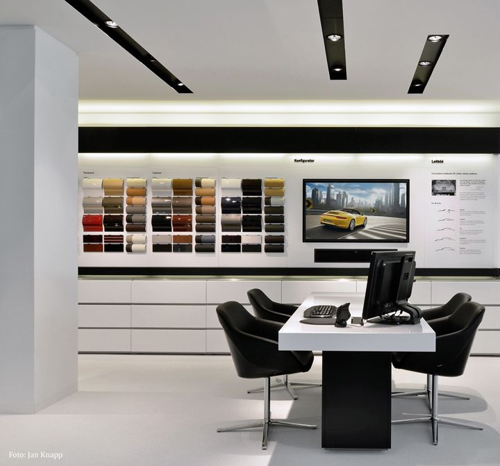 Porsche showroom by the store designers visit city - Interior design lighting companies ...