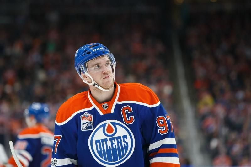 McLachlan/Getty Images Edmonton Oilers phenom Connor McDavid finished Sunday with two assists against the Vancouver Canucks to total 100 points for the season. While Sunday's effort wasn't required to lead the league in scoring, McDavid—aged 20 years and two months—became the third-youngest player in NHL history to win the Art Ross Trophy, per Sportsnet Stats. Sidney Crosby was the youngest to do it at 19 years and eight months, with Gretzky just slightly ahead of McDavid, also at 20 years…