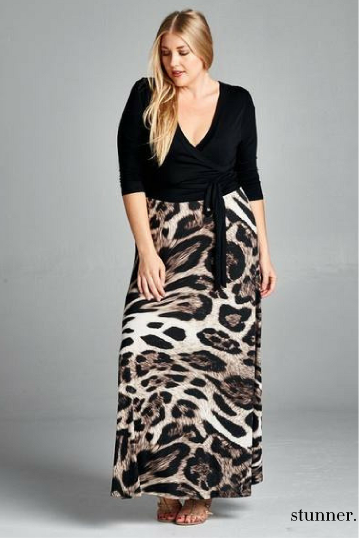 41e707fb79 This  Stunner plus size maxi features a leopard-printed long length skirt  and a black wrap V-neck top for added effect.