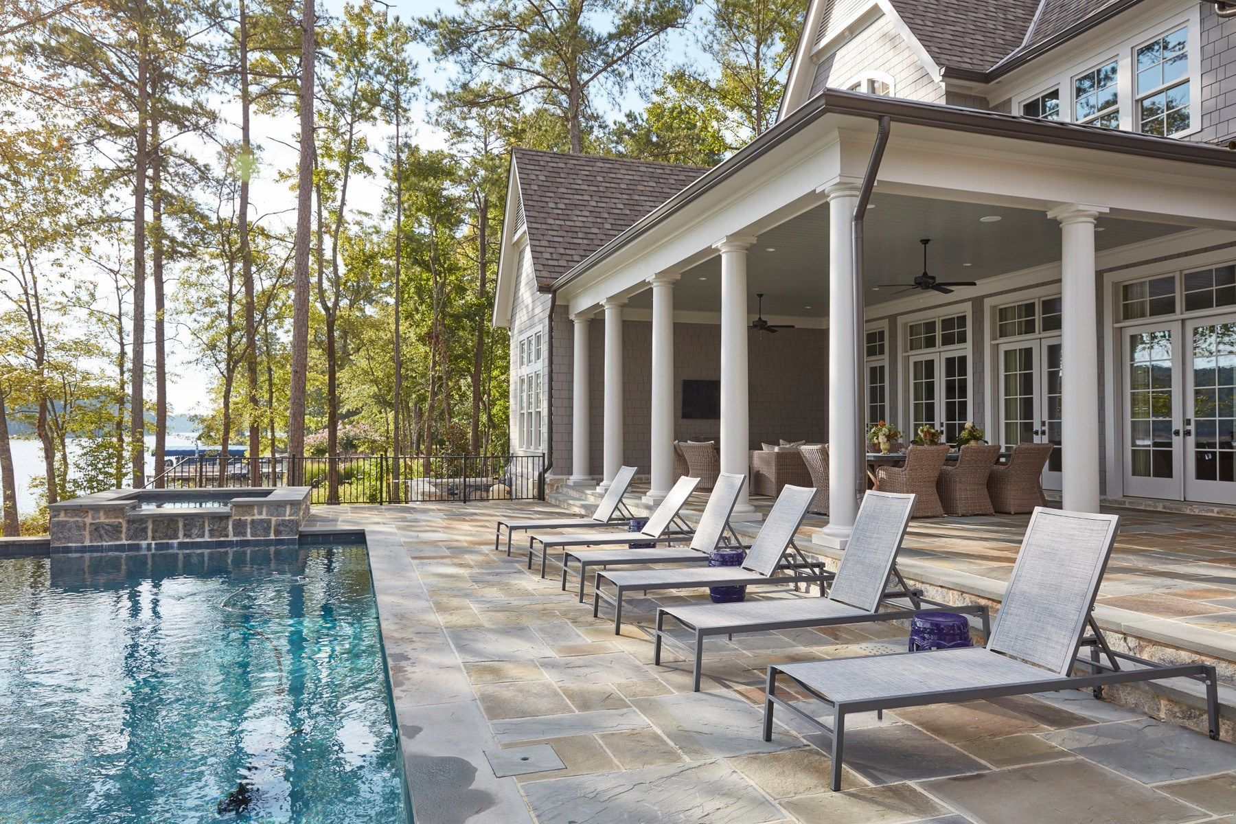 Lake House Chic A Beautiful Second Home Is The Perfect Escape House With Porch Lake House Porch Design