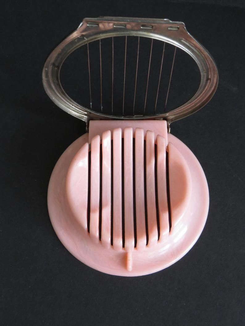 1960s pink egg slicer and spoon rest retro pink kitchen