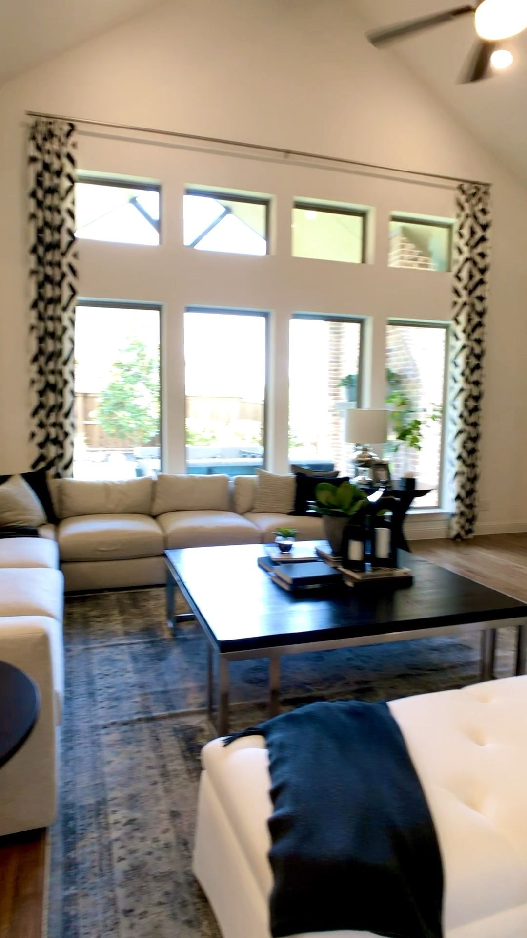 Beautiful model home tour with open floorplan living room & kitchen with a wallpaper design in the dining room...video by THE DECORATING COACH... Click to see more model home photos for decorating inspiration... #decoratingideas #decoratingtips #openconcept #livingroomdecor