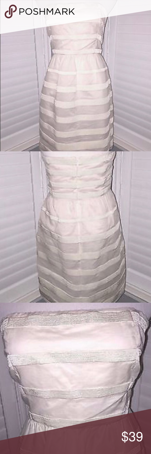 NWT J CREW Cream Striped Strapless Dress Sz 10 NWT $128 J CREW Gorgeous Cream Striped Strapless Fully Lined Dress Size 10This is such a great J Crew fully lined strapless dress that is NWT! It has two side, slip pockets and an invisible back zipper. It is strapless with silicone band at the top and boning along with an elastic bra type strap on the inside. The stunning fabric is sheer with ribbed ribbon in graduated widths from the top to the bottom. Don't miss out on this fabulous dress! J…