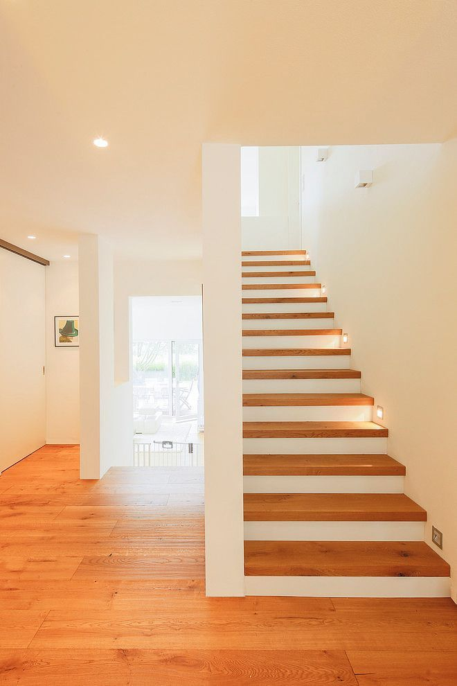 simple way to get continuity of wood flooring on stairs like how clean the white paint is. Black Bedroom Furniture Sets. Home Design Ideas