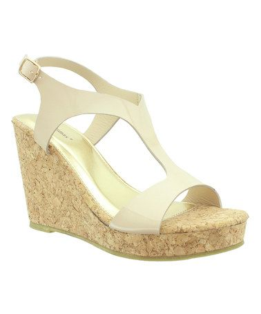 e34bc39fe680 Shiny straps lend a hint of glamour to these playful platform sandals for a  look that s flirty and fashionable.