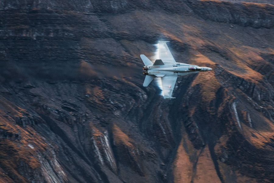 Smokin' Hornet. A swiss F/A-18 in a sharp turn with the alps in the background.