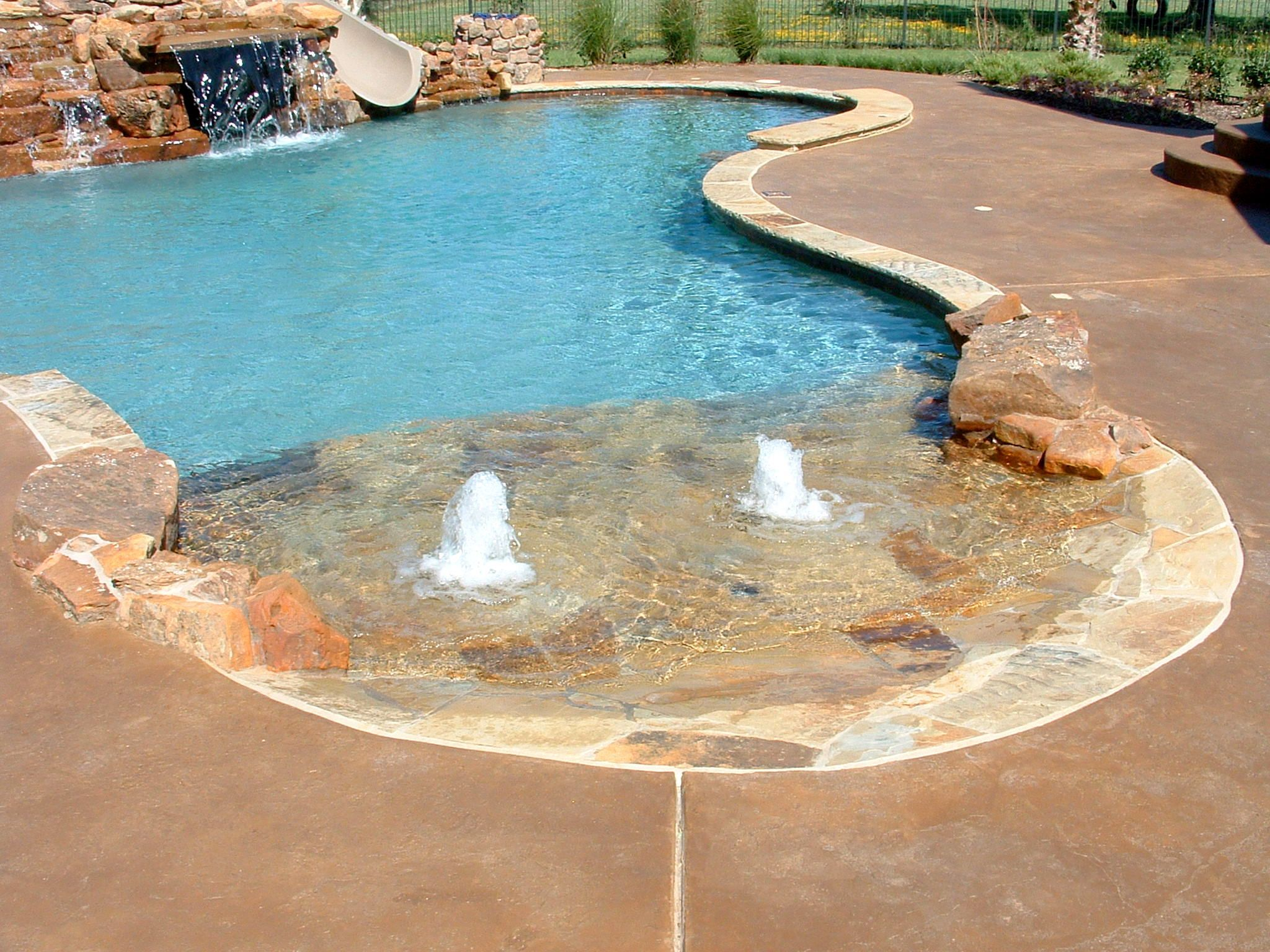 swimming pool custom features beach entry slide bench additions southlake texas - Custom Swimming Pool Designs