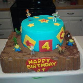 "Toy Story Birthday Cake for a friend's son. She provided the figurines. The ""dirt"" is Oreos, sugar, and coco powder."