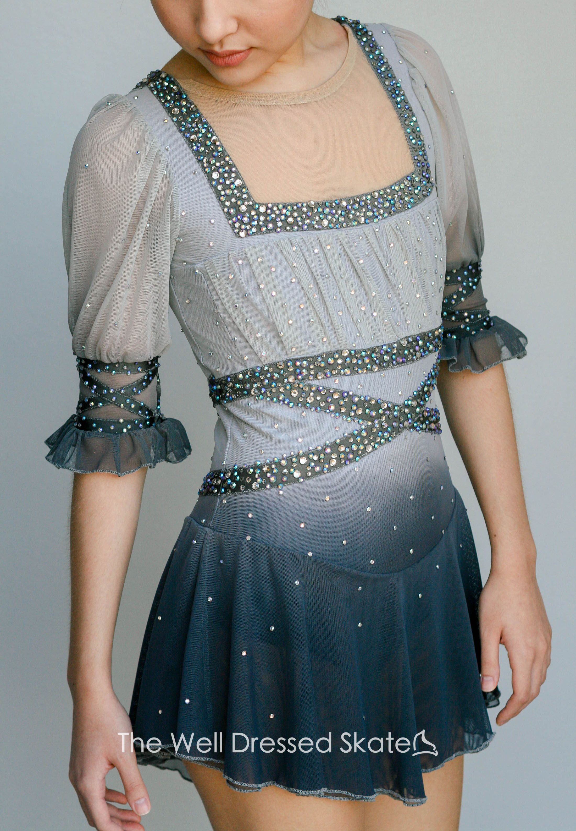 Photo of Grey Ombré peasant inspired figure skating dress. Skating to 'Les Miserables' – Our Figure Skating Dresses