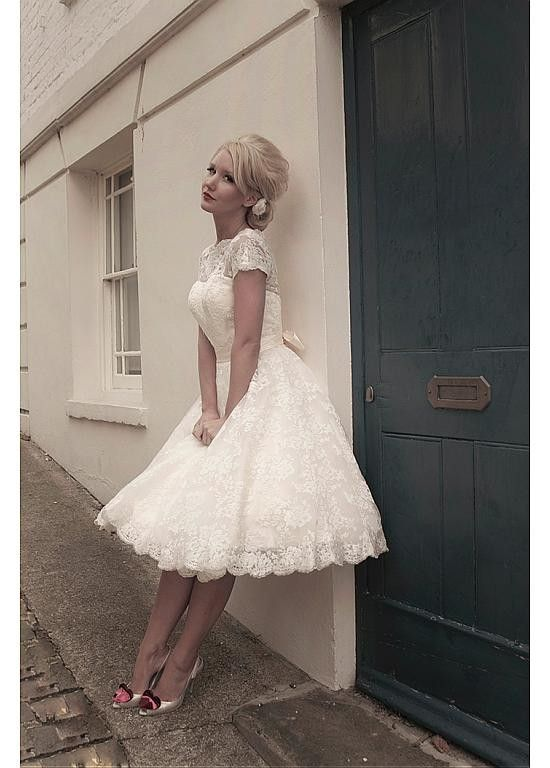 This chic wedding dress is made of satin inside and all-over lace outside. The belt is made of satin. This charming wedding dress shapes a bateau neckline and a knee length skirt shows your beautiful leg and good figure. You should getthis perfectwedding dressfor your perfect wedding.