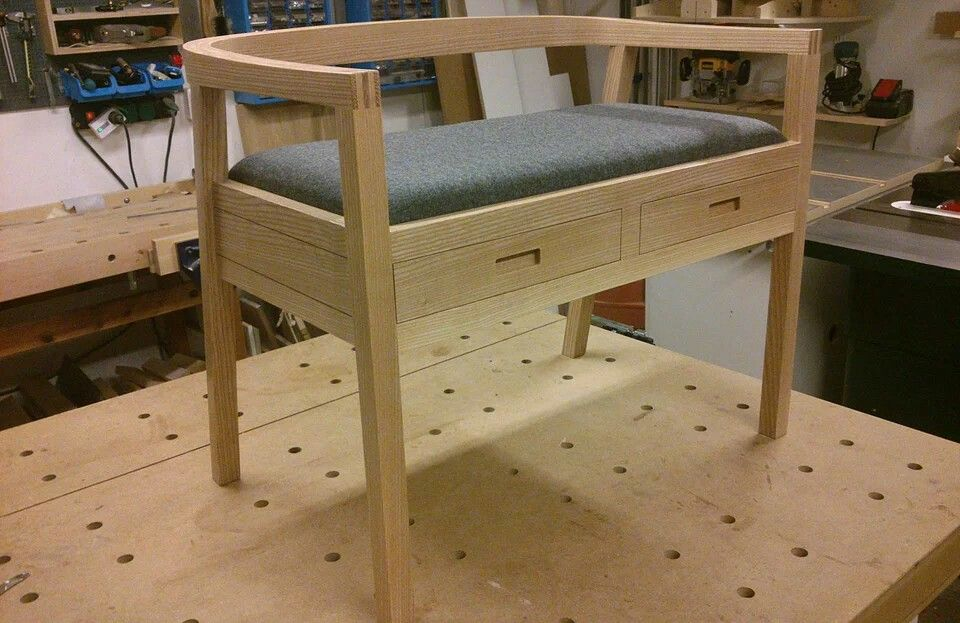 Small seating bench with drawers. Bent lamination back, solid ash, wool seat.