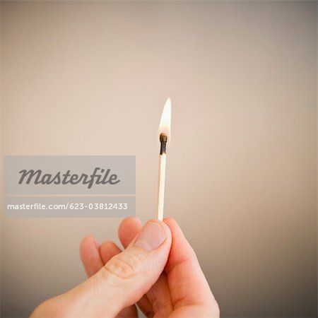 Lighting a match Stock Photos - Page 1 : Masterfile