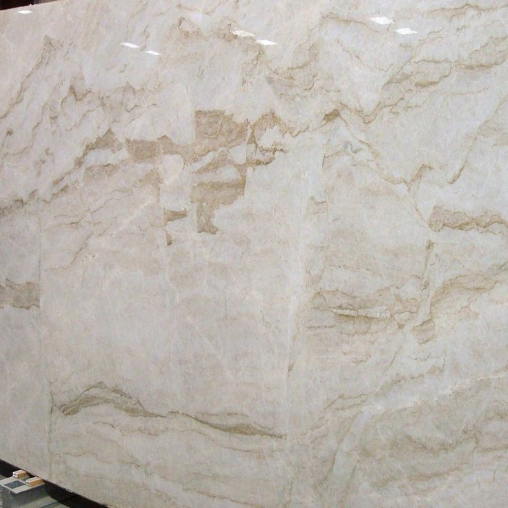 Quartzite Stone Slabs : An elegant cream color quartzite with marble like veining