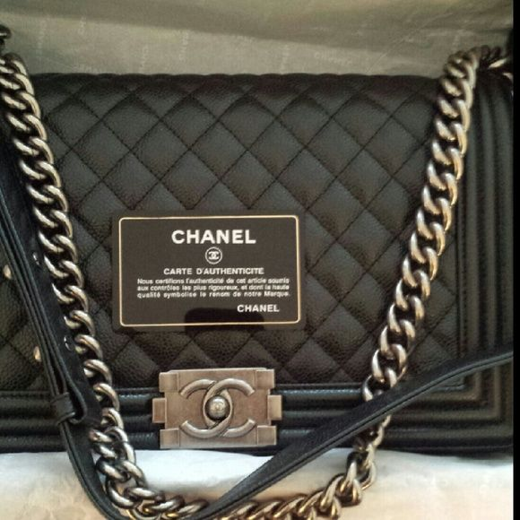85e71b68cbee Authentic Chanel Black Caviar Medium Boy Flap Bag This is the Caviar  leather Le Boy Flap Chanel with Ruthenium hardware. It is approximately  28cm.