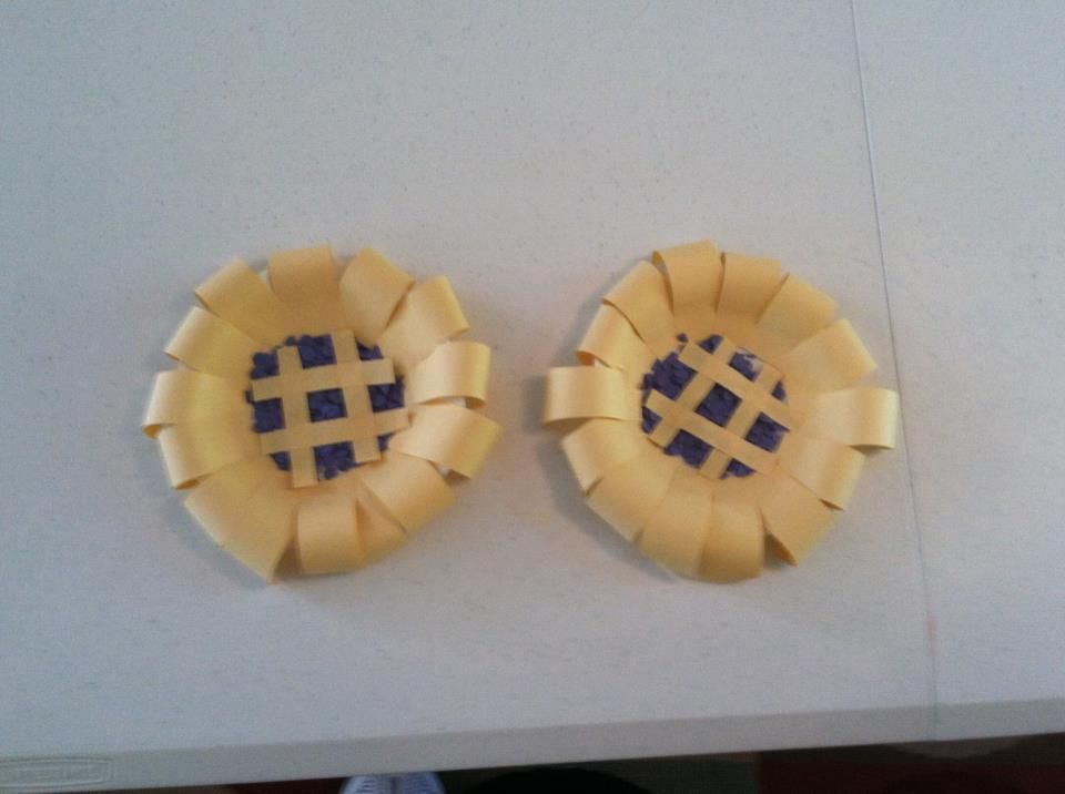 """The color of the week was blue so we made blueberry pies.  The blueberries were made from using a hole puncher on blue construction paper. The crust was made from cream colored construction paper. I used scissors to """"curve"""" the crust."""