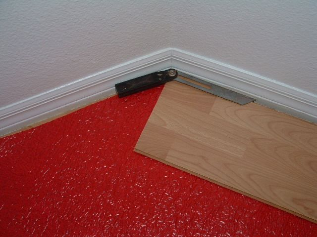 Using The Angle Finder Tool To Cut Angles When Installing Laminate Flooring.