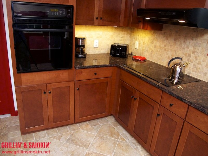 Chicago brick flooring with granite counter tops new for Kitchen cabinets 12x12