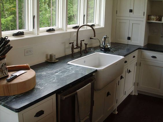 White Farmhouse Sink With Slate Counter Top Light Wood Cabinets
