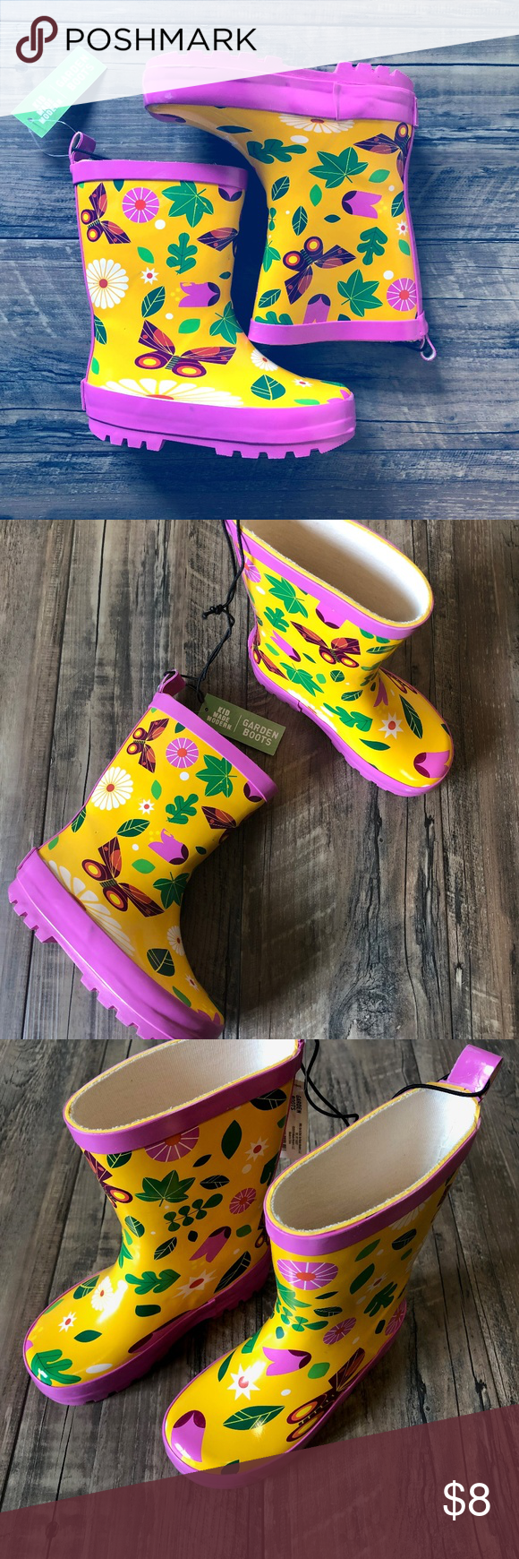 Kid Made Modern Butterly Rain Boots Bring some cheer to a rainy day with the Butterfly Garden Rain Boots from Kid Made Modern! With a pink trim on the top-line and soles, these rubber rain boots make for a cute addition to any outfit. A bright pattern of flowers and butterflies on a yellow background make for a nice pop of color, keeping your little one looking cute and comfy as they splash around in puddles. Kid Made Modern Shoes Rain & Snow Boots #rainydayoutfitforwork