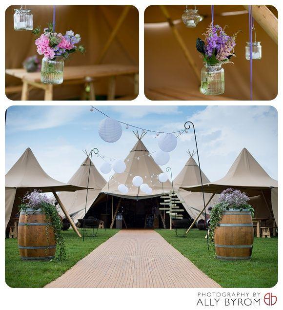 Boutipi tipis, paper lanterns, barrels, jam jars pink & lilac, ivy.