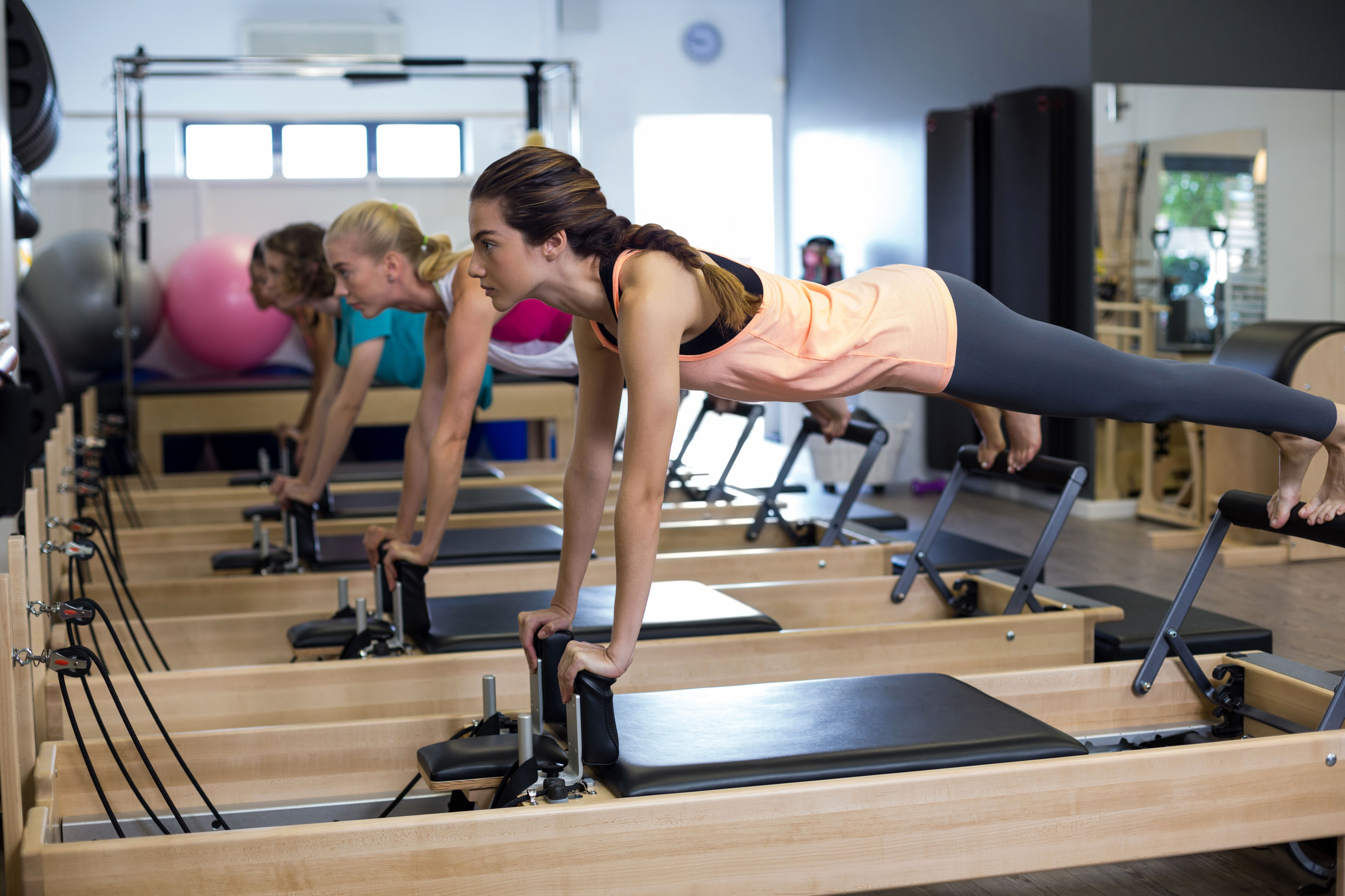 The 5 Best Stretches You Can Do On The Reformer Top 5 Pilates Reformer Pilates Reformer Exercises Pilates Workout