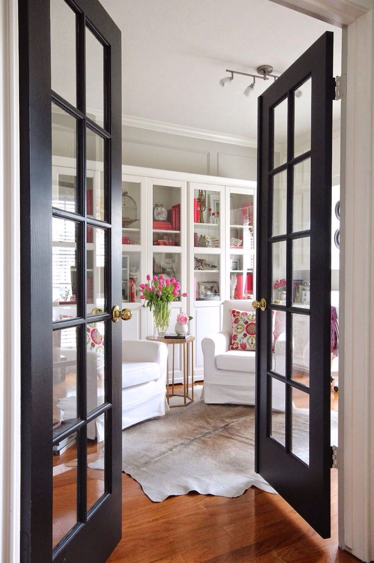 Love the french doors and flooring doors to library paint the same as shelves