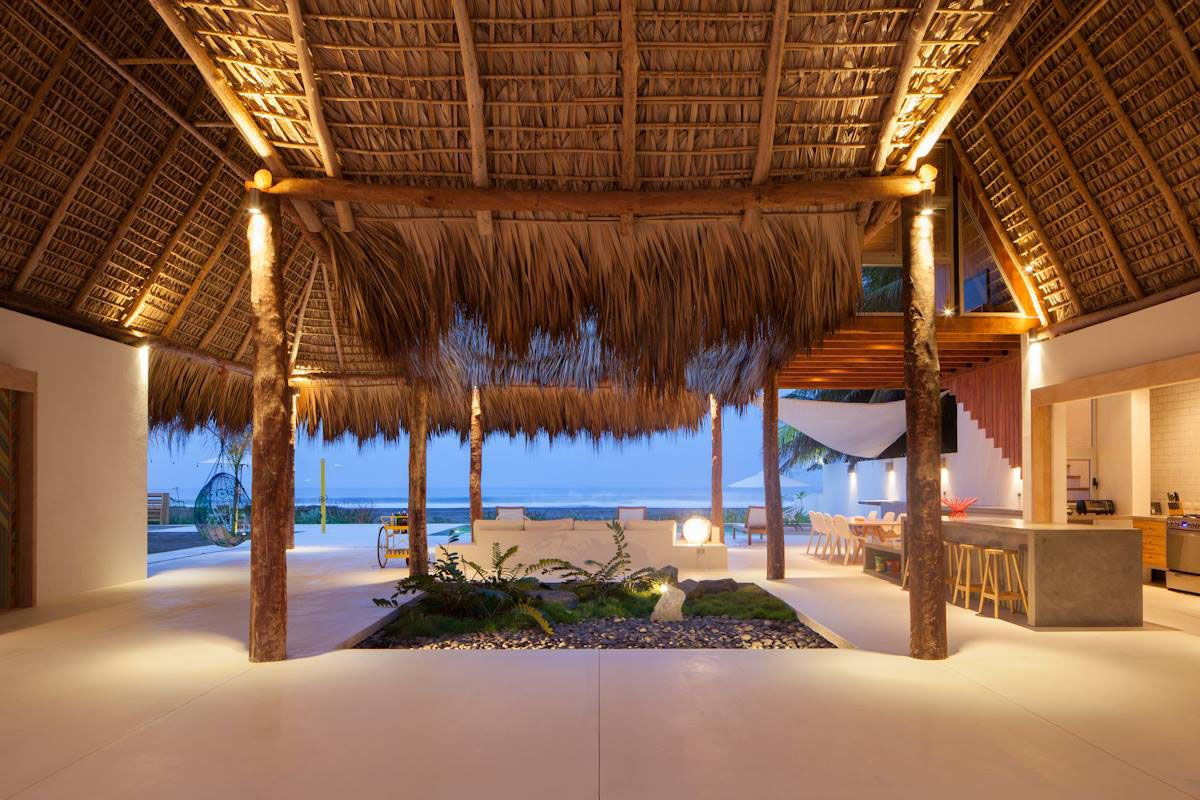 tropical beachfront home with thatched roof | kitchens and eating