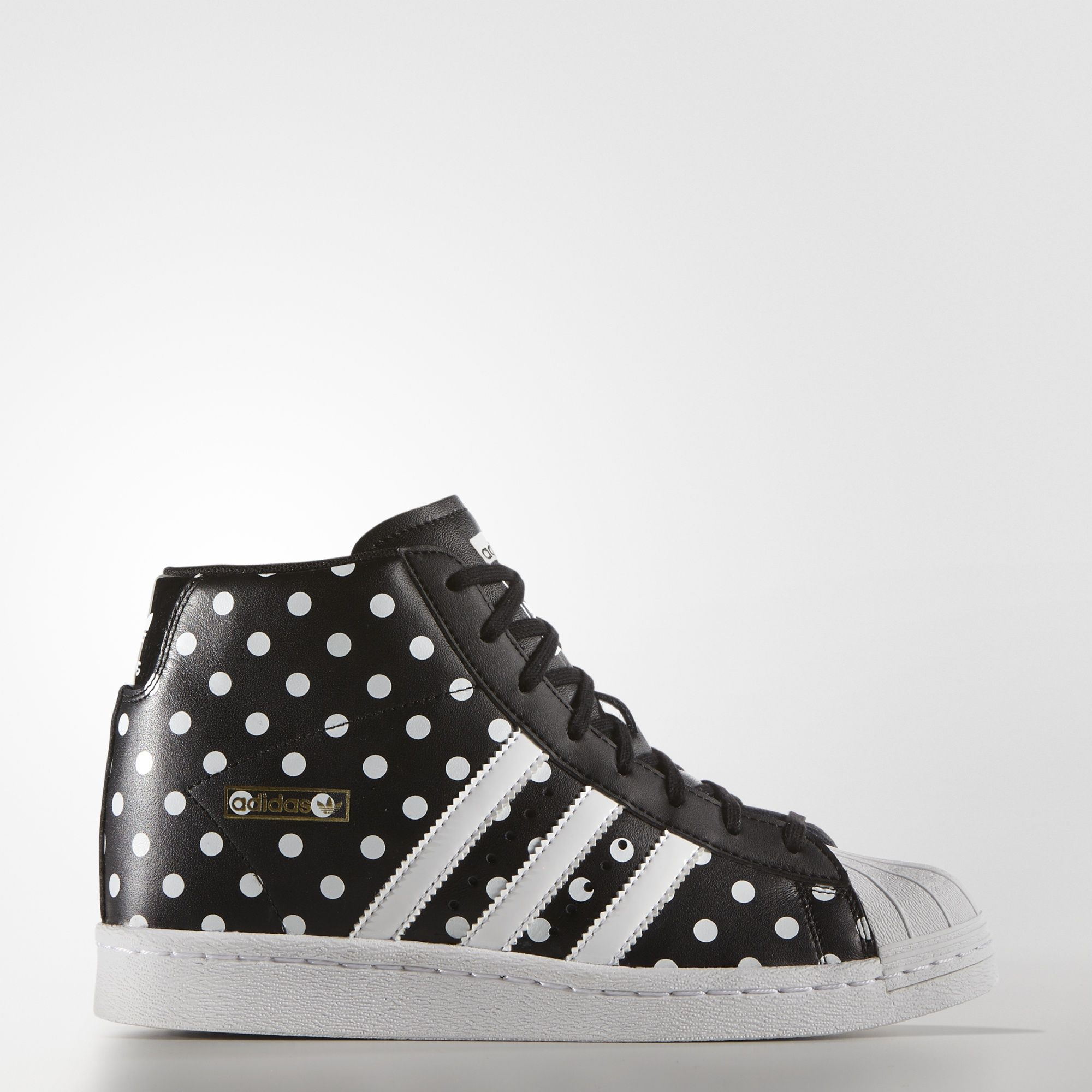 A hidden wedge heel gives soaring style to the adidas Superstar sneaker.  These women's shoes