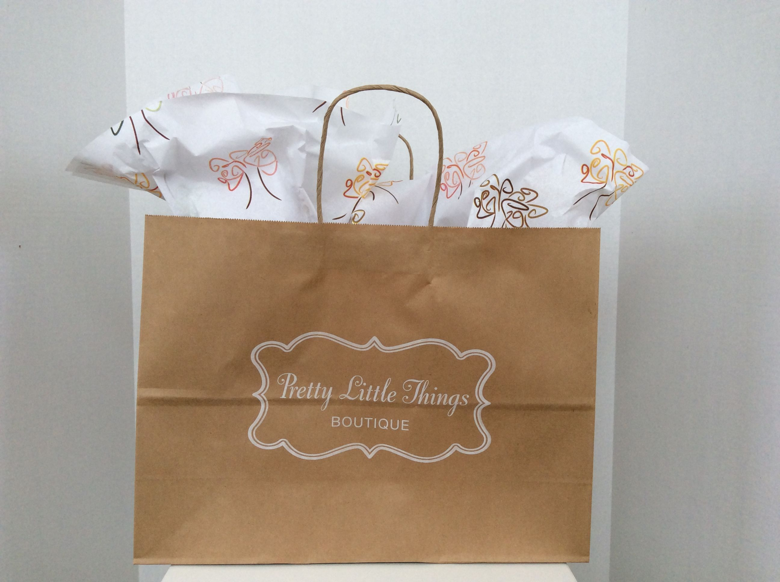 Natural kraft paper twist handle bag ink printed with a white logo