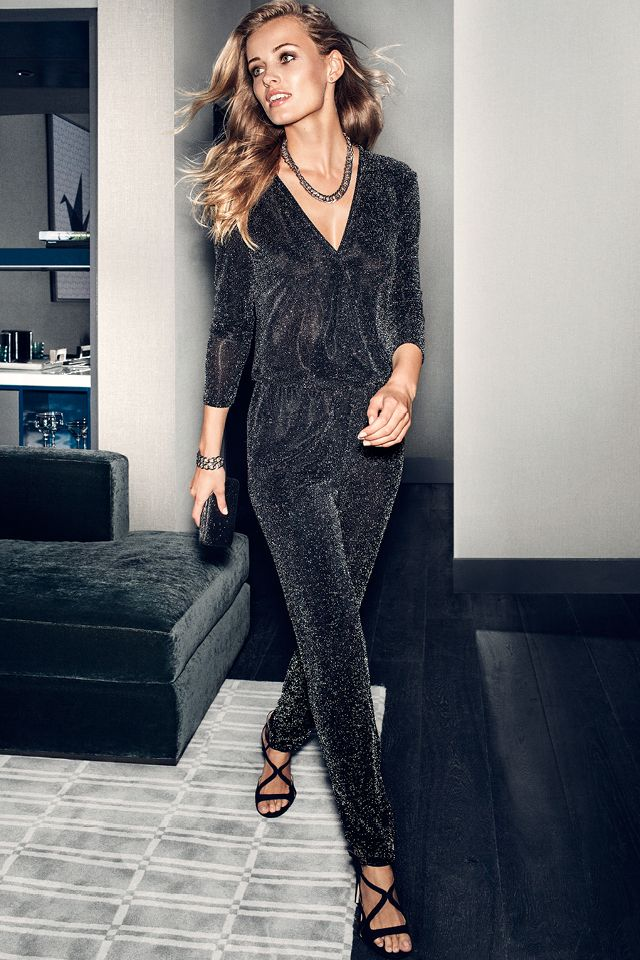 Black Long Sleeve Jumpsuit In Glittery Jersey With Wrap Style Front