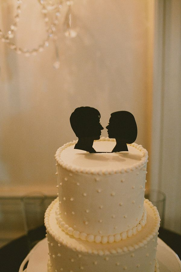 silhouette cake toppers, photo by @Jillian Medford Wishart http://ruffledblog.com/scottish-tartan-wedding #caketoppers #cakes #wedding
