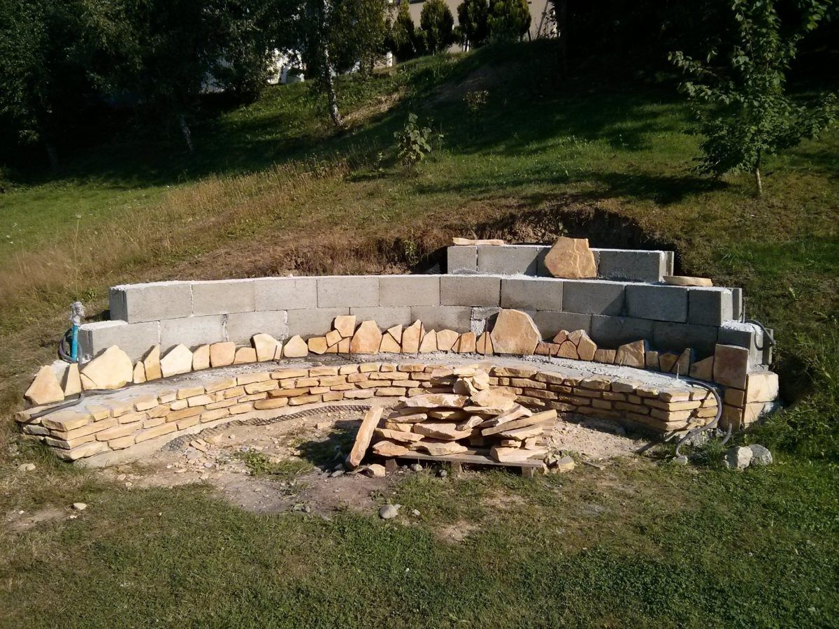 They Built A Fireplace Into Their Sloping Hillside – The Results Were and Are Stunning