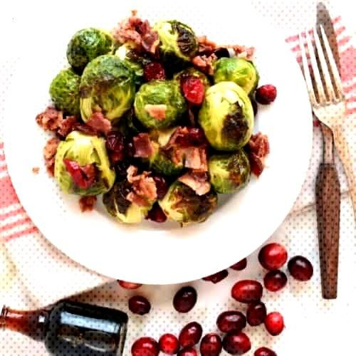 Roasted Brussels Sprouts are a tad sweet with crispy leaves on the outside. Bacon, cranberries, and