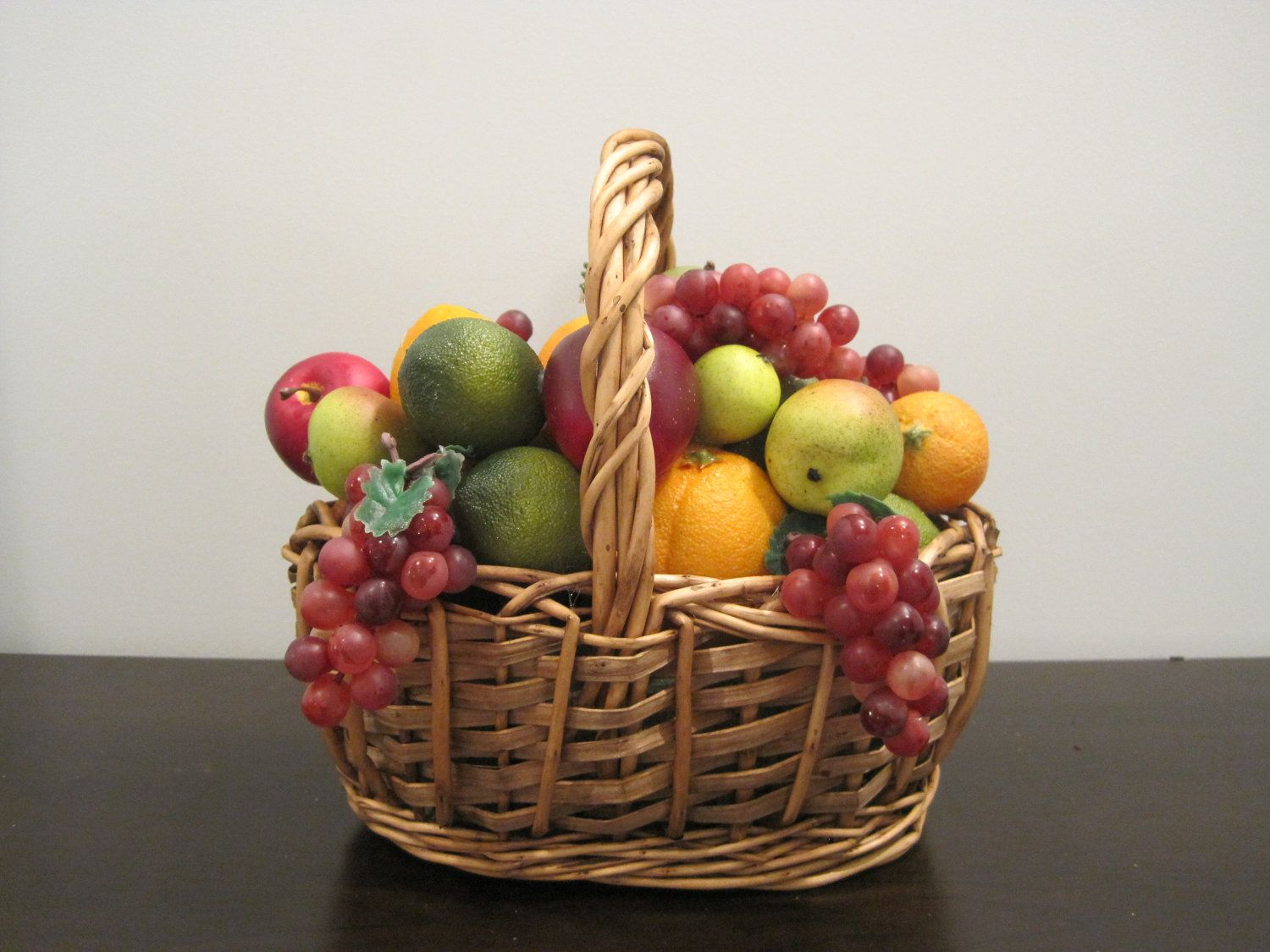 Plastic Fruit Basket On The Kitchen Dining Table When I Was A Ager My Mom Had One Of These And Remember Plucking G Off Chewing Them