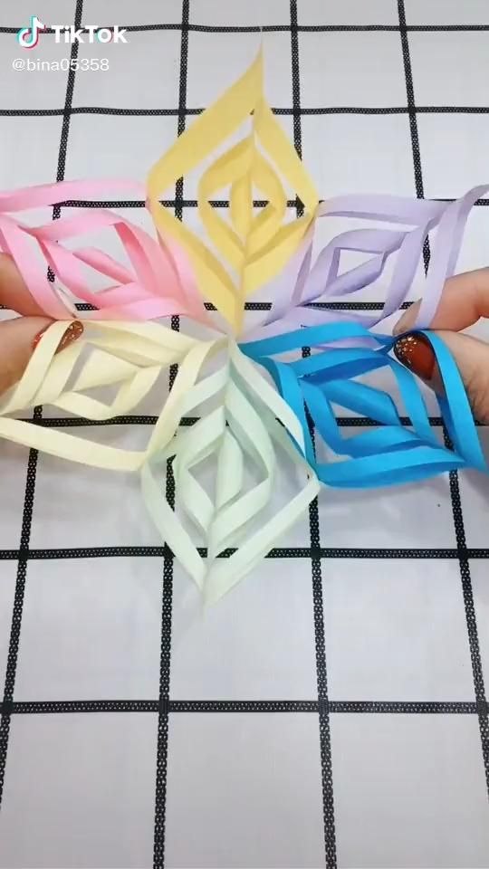 Photo of Origami. Colorful paper cut. A beautiful flower.