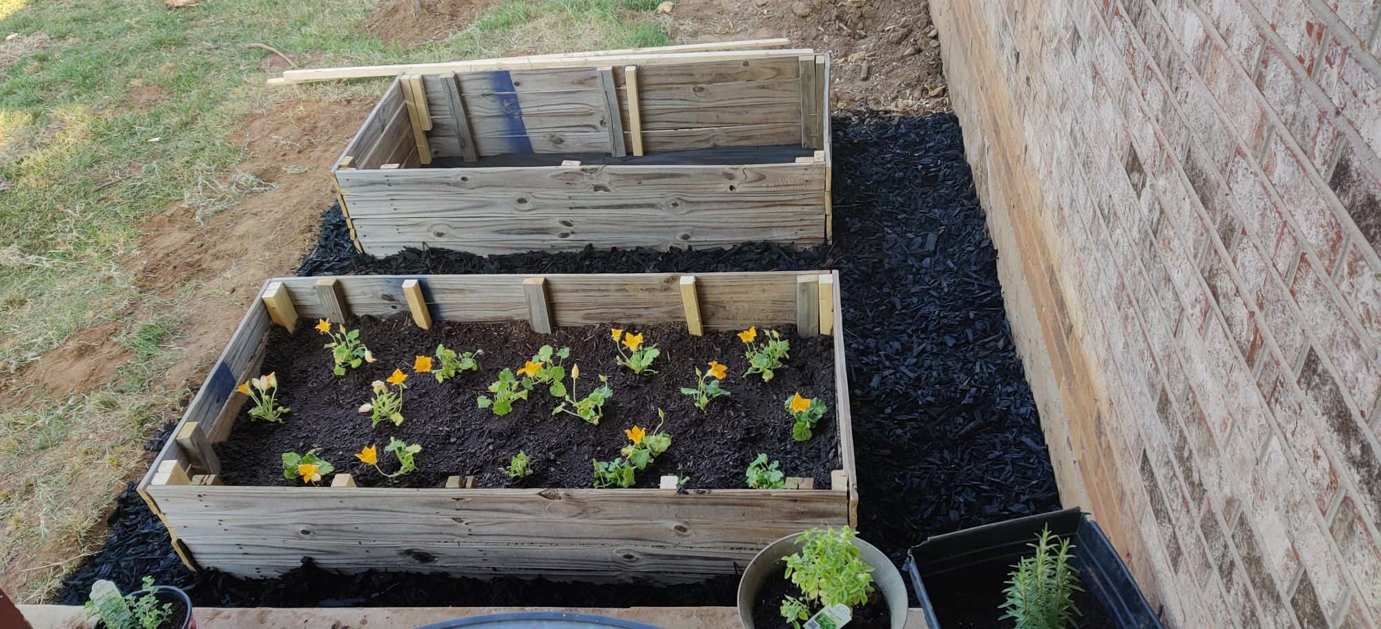 Raised garden bed. Made out of one old fence panel. in