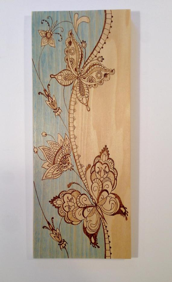 Butterflies and flowers wood art – wood burned art – blue wash background – pyrography