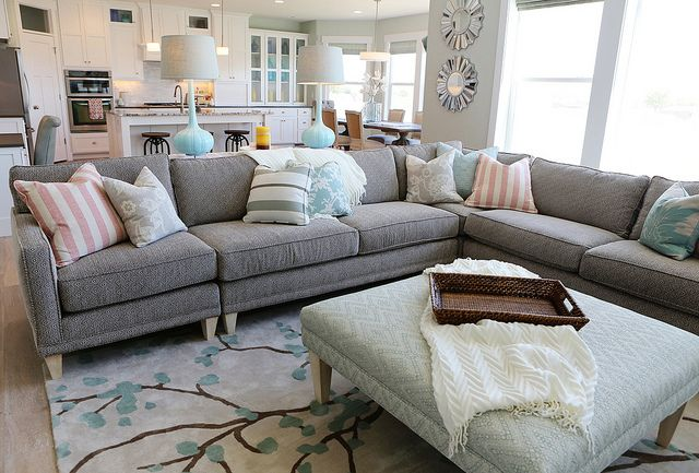 grey sectional with print.. i love the pops of color ... not everything matches. dig it.