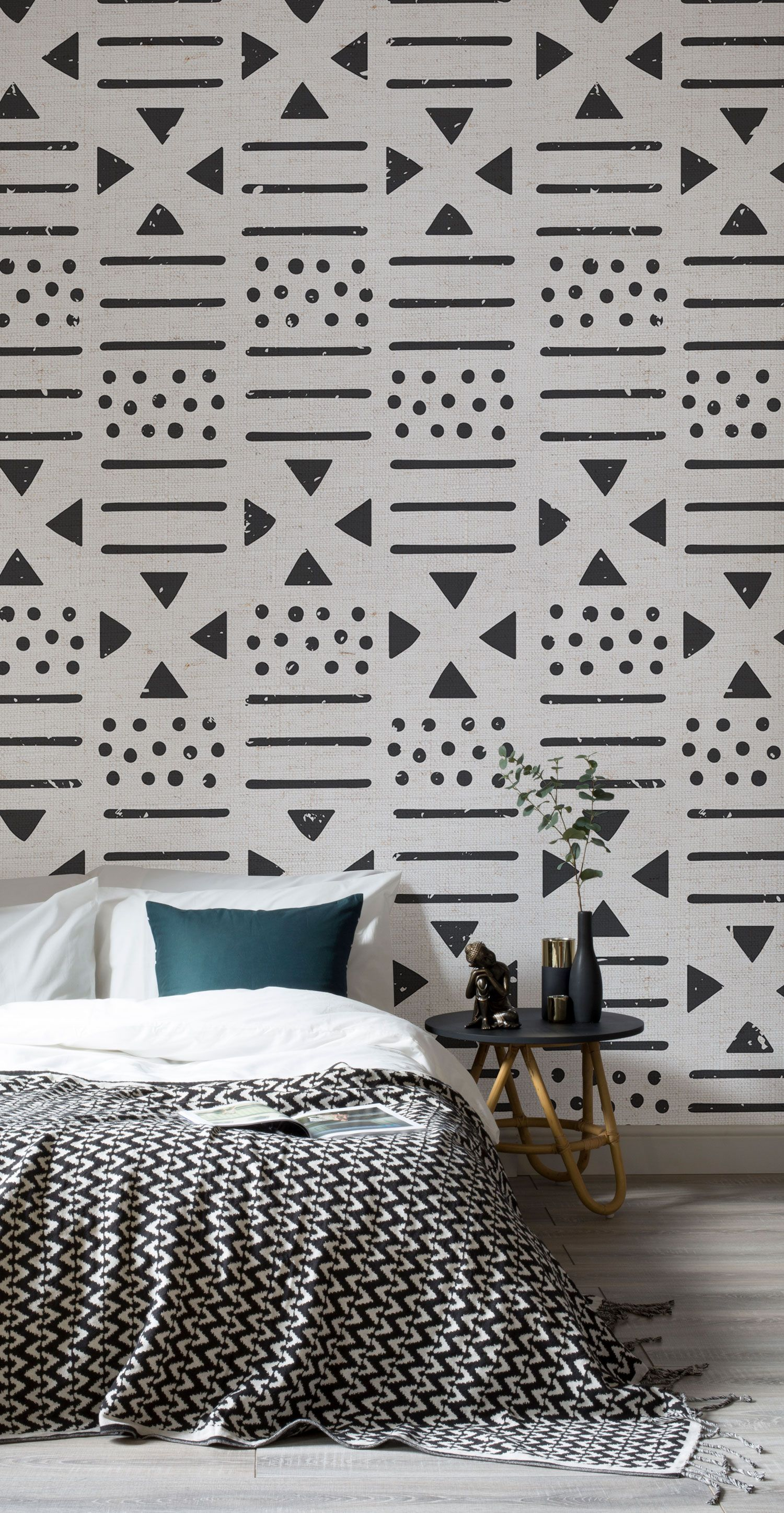 This tribal inspired wallpaper draws inspiration from around the world combining a neutral palette with big bold motifs that help your bedroom spaces
