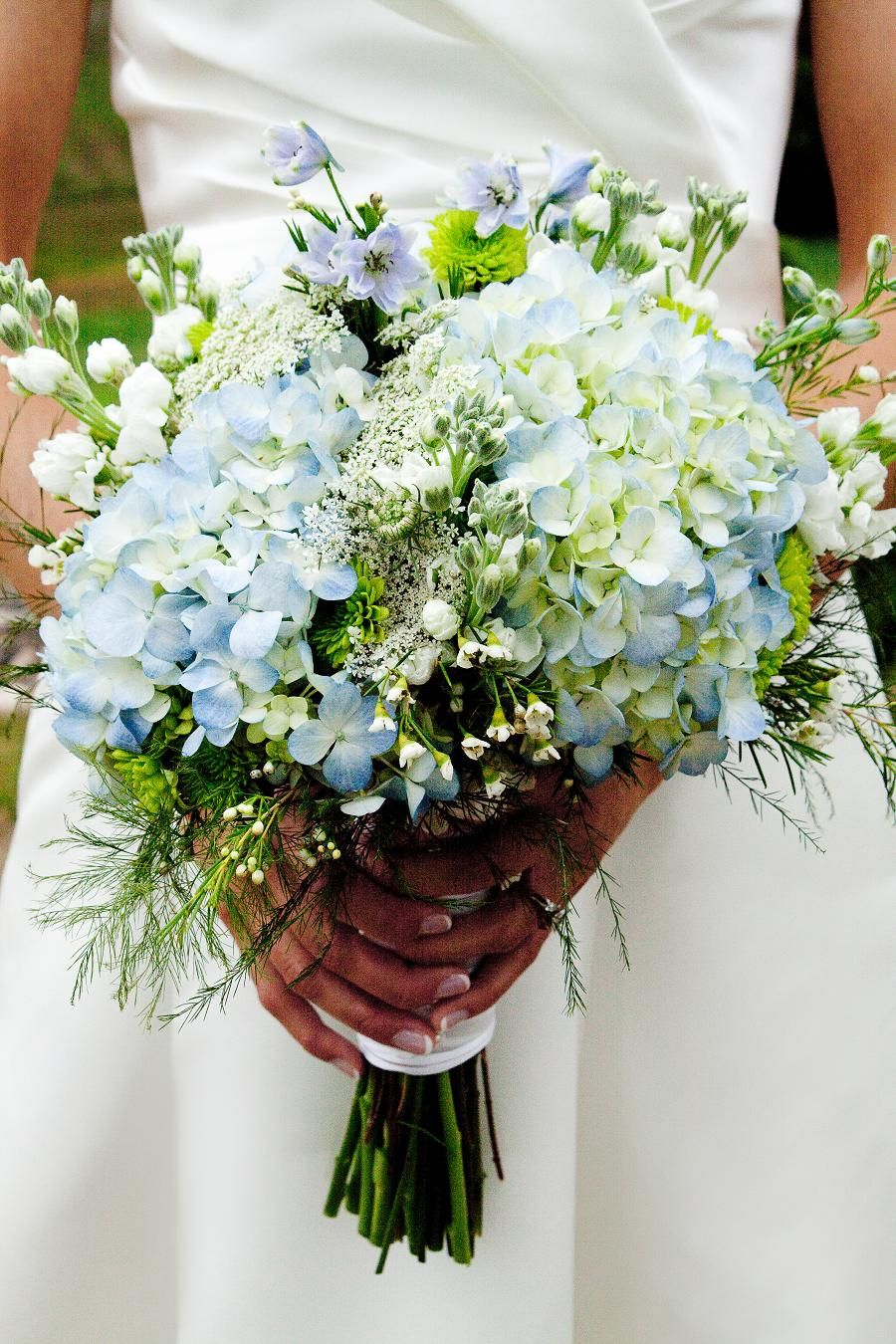 Hydrangeas increase the romantic feel of this bouquet