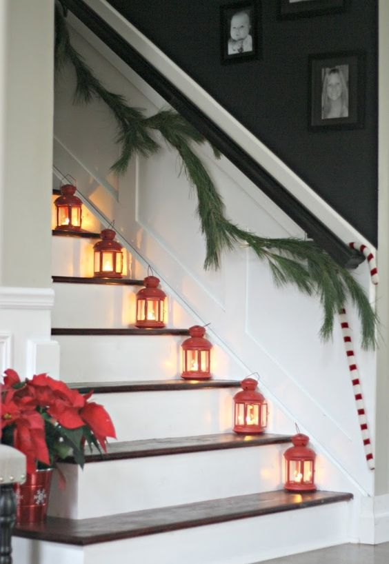 Delightful Red Lanterns Placed On The Stairs And An Evergreen Garland