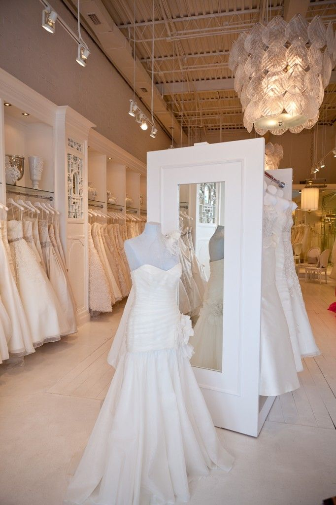 Lighting And Mirror At The End Of The Rack With Images Bridal Showroom Bridal Shop Decor Bridal Shop Interior