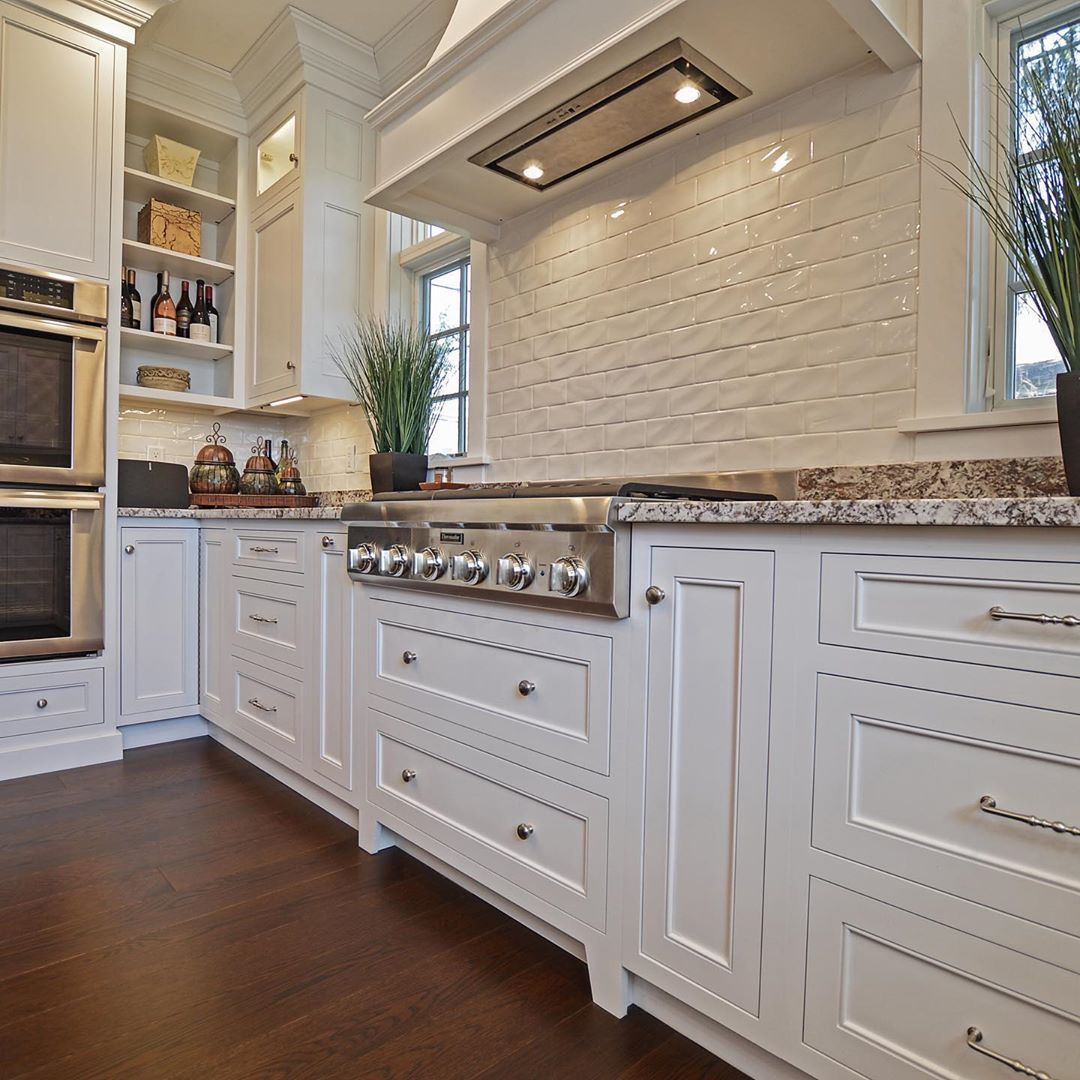 Clean, white cabinetry simply doesn't go out of style.. #timelessdesign  Love looking back at ou...