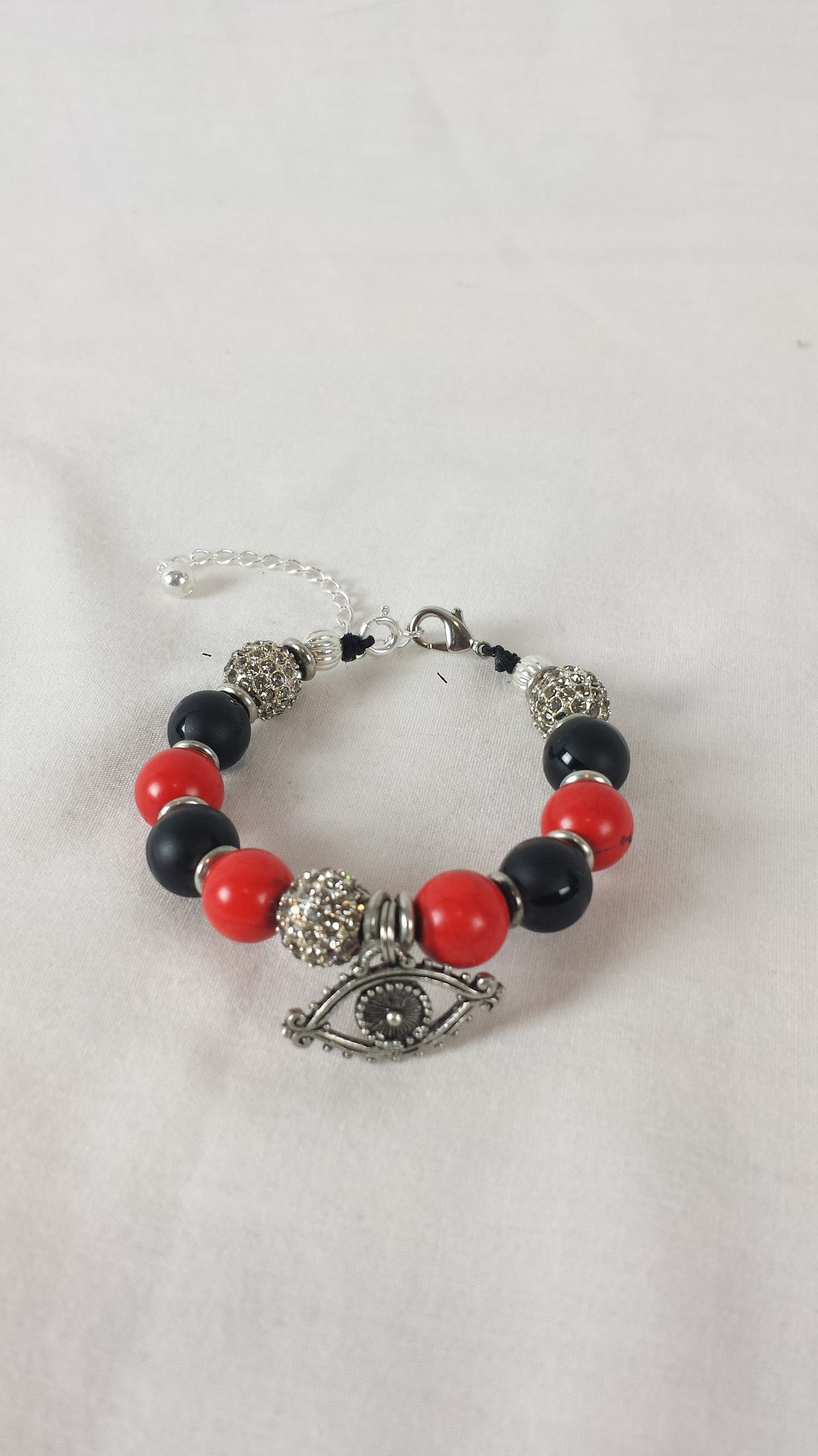 Coral and onyx eye bracelet made with coral red matte black onyx